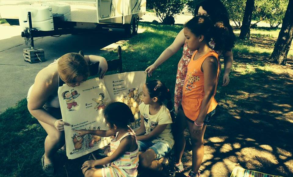 Weekly summer visits to Cole's Mobile Home Court provide reading enrichment, creative activities, and fresh snacks for elementar